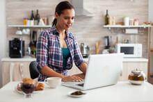 Woman Smiling Using Laptop In ...