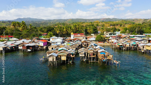 Fishing village with wooden houses on stilts in the sea Fototapet