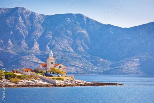 Fototapeta Lighthouse of Sucuraj on Hvar island and Biokovo mountain background view obraz