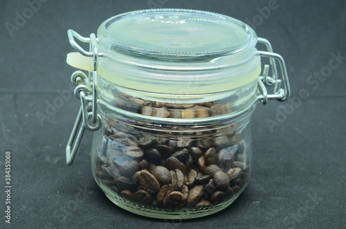 coffee beans in a glass jar with a closing lid