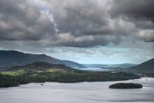 Beautiful Moody Landscape Image Of View From Surprise View Viewpoint In The Lake District Overlooking Derwentwater With Skiddaw And Grisedale Pike In The Distance