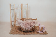 A Basket For A Newborn Baby With A Wooden Pink Swing Horse
