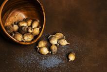 Bowl Full Of Dry Poppy Pods Wi...