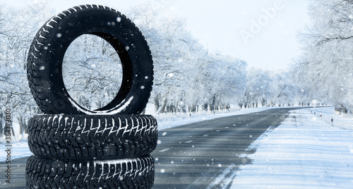 Winter tires on a snowy road. Seasonal tire change.