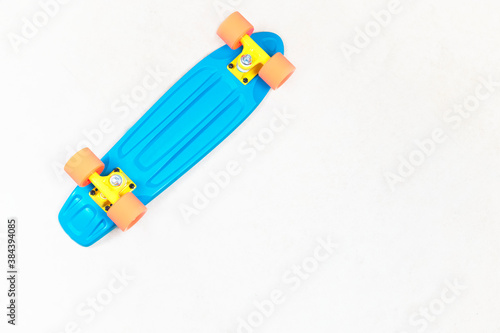 Cuadros en Lienzo Skateboard cruiser style blue yellow and orange view from above