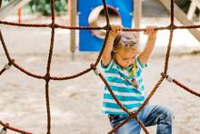 Toddler Girl At Playground Climbing On Jungle Gym