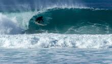 Surfer Near The Town Of Carmel...