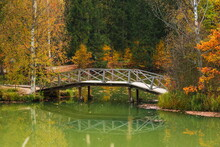 Wooden Bridge On A Pond In An ...