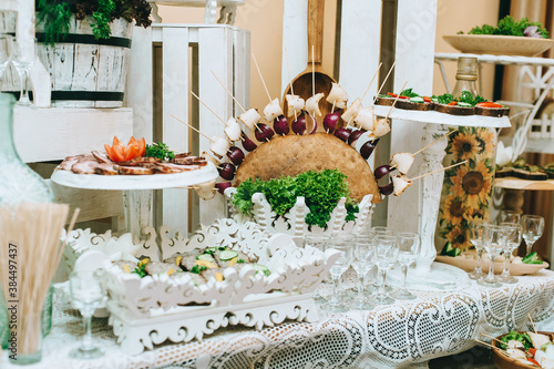 Obraz na plátně Beautifully decorated catering banquet table with different food snacks and appetizers