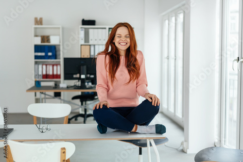 Fototapeta Cute excited charismatic young woman grinning obraz