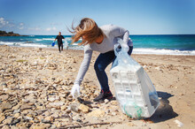 Volunteers Cleaning Beach Area From Plastic