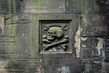 Memento Mori Sign In Mossy Stone Wall At Greyfriars Kirkyard