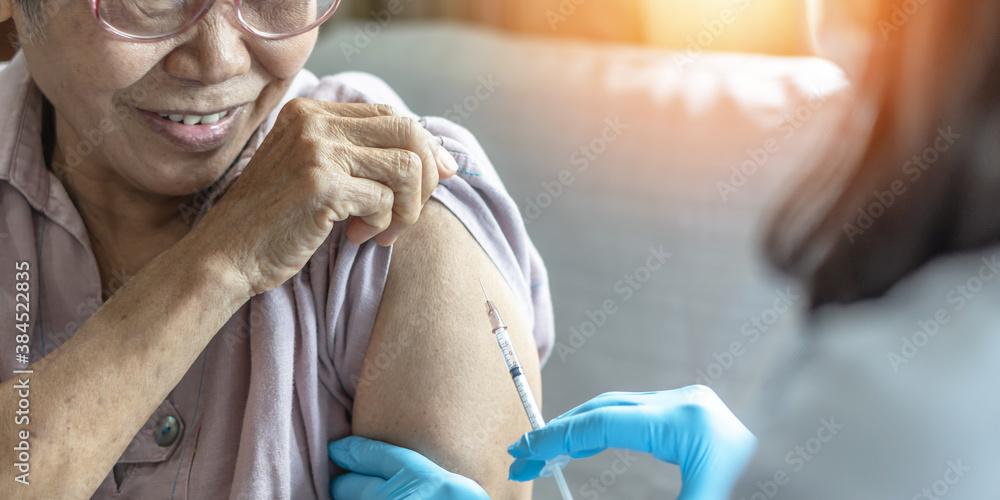 Fototapeta Vaccine shot for elderly vaccination, medical immunization for aging senior woman, older patient, geriatric treatment from disease such as coronavirus, covid-19, Influenza, pneumococcal or hepatitis B