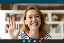 Close Up Screen View Of Smiling Young Caucasian Woman Wave To Camera Greeting Talking On Video Call At Home. Happy 30s Female Have Webcam Digital Conference Or Conversation. Virtual Event Concept.
