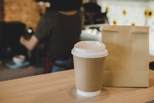 Hot Black Coffee Cup And Dessert Paper Bag Waiting For Customer On Counter In Modern Cafe Coffee Shop, Food Delivery, Cafe Restaurant, Takeaway Food, Small Business Owner, Food And Drink Concept