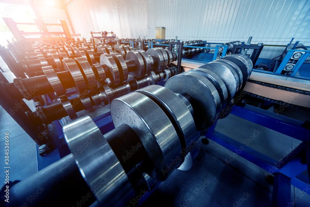 Fototapeta Metal sheet forming machine at the modern metalwork factory.