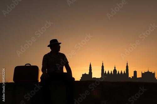 man in front of zaragoza city skyline in spain