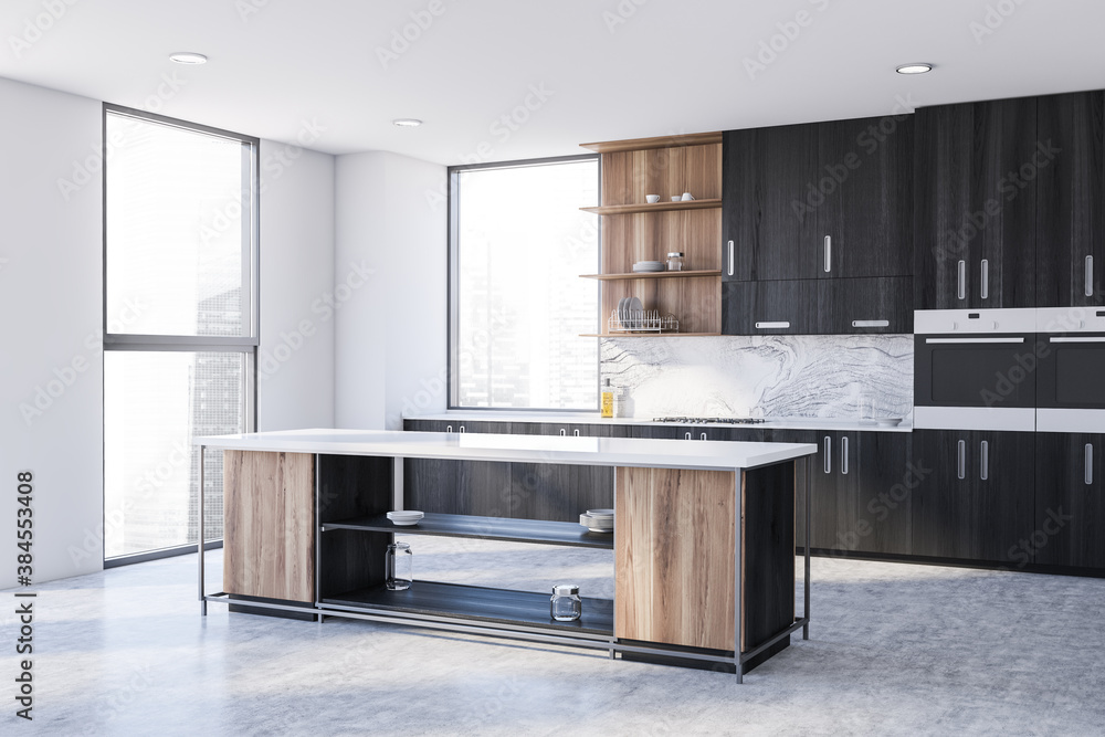 Fototapeta White and black kitchen corner with cabinets and island