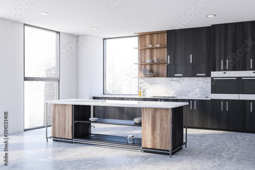 Obraz White and black kitchen corner with cabinets and island - fototapety do salonu