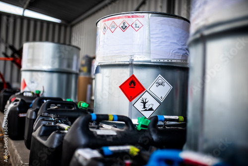 Fototapeta The storage of toxic waste and chemicals in metal cans on the factory premises o