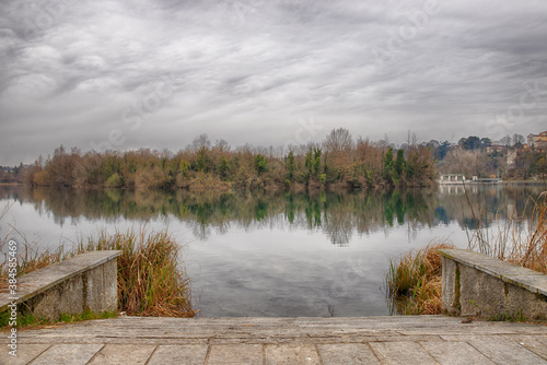 Pier on the river Adda, in Trezzo sull'Adda. Rainy day Canvas Print