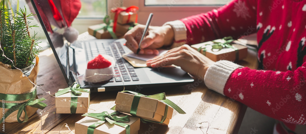 Fototapeta Christmas online shopping, sales and discounts promotions during the Christmas holidays, online shopping at home and lockdown coronavirus.Xmas.