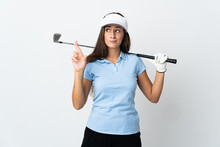 Young Golfer Woman Over Isolated White Background With Fingers Crossing And Wishing The Best