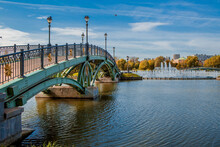 Russia. Tsaritsyno Park In Moscow On A Sunny Autumn Day. View Of The River, Bridge And Large Fountain. Tsaritsyn Park Is One Of The Main Tourist Attractions In Moscow.