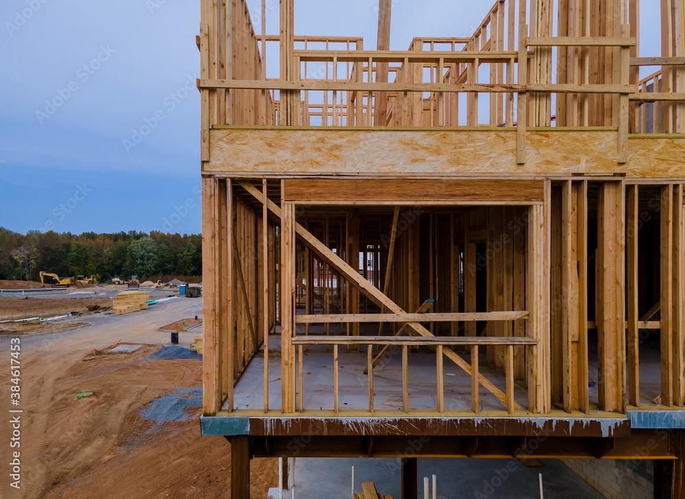 Fototapeta Wood building frame structure on a new development