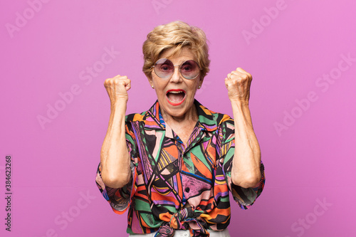 old pretty woman feeling happy, positive and successful, celebrating victory, ac Wallpaper Mural