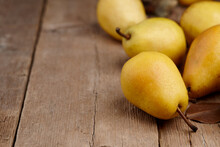 Yellow Pears On Wooden Table, Close Up View