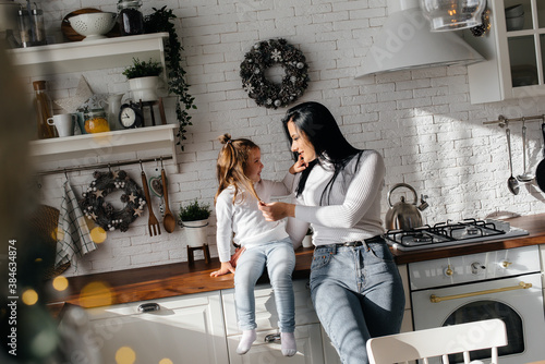 Mom and Little Daughter are preparing for the holiday and playing Wallpaper Mural