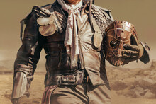 Photo Of A Post Apocalyptic Raider Warrior Torso In Leather Jacket With Metal Armor Standing In Wasteland With Steel Mask.