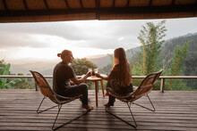 Happy Couple Sit On Wicker Cha...