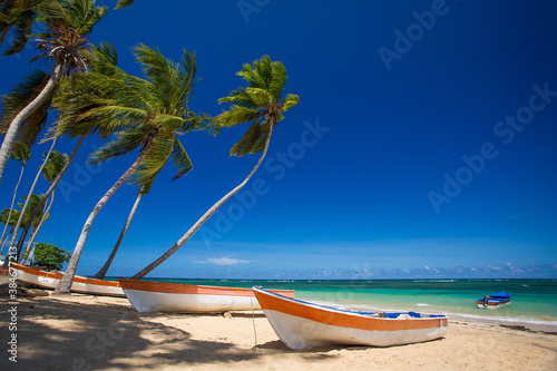 Fototapety, obrazy: Paradise beach with fishing boats, white sand, palm trees and blue water of Atlantic Ocean, Las Terrenas, Samana, Dominican Republic
