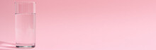 Glass Of Water On A Pink Background, Long Banner