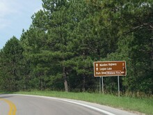 Roadside Sign With Distance And Directions To Needles Highway, Legion Lake And Park Shop, Custer State Park, South Dakota.
