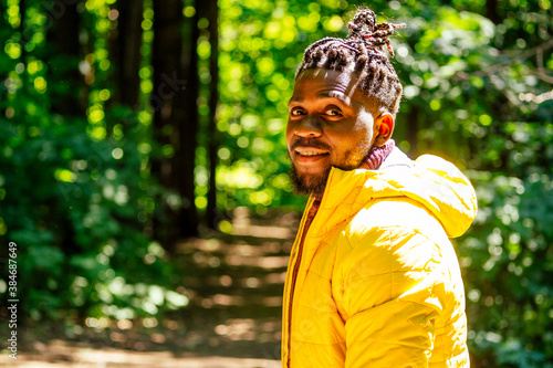 african american man in yellow jacket with a hood and dreadlocks pigtails Wallpaper Mural