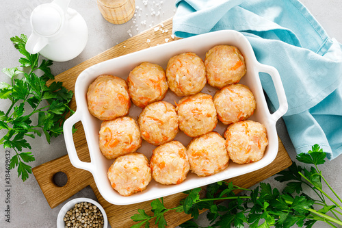 Raw fresh chicken meatballs with rice and vegetables Fototapet