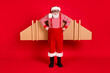 Leinwandbild Motiv Full length body size view of his he handsome strict bearded Santa father wearing jet air wings celebrate eve noel newyear isolated bright vivid shine vibrant red color background