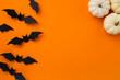 Leinwandbild Motiv Happy halloween holiday concept. Halloween decorations, pumpkins and bats on orange background