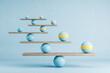 Leinwandbild Motiv Scales with blue ball on blue background.
