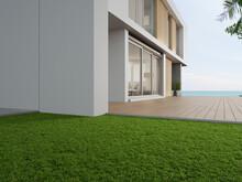 Empty Outdoor Wooden Floor Terrace Near Green Grass Garden In Modern Beach House Or Luxury Villa. Building Exterior 3d Rendering With Sea View.