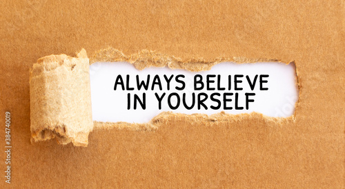 Valokuva Text Always believe in yourself appearing behind torn brown paperText Culture ap