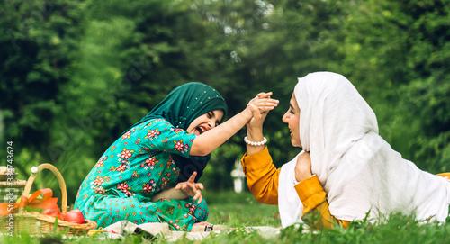 Fotografie, Obraz Portrait of happy religious enjoy happy love asian family arabic muslim mother a