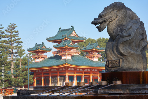 Fotografering Dragon statue over water ablution basin with Byakko-ro Tower of Heian-jingu Shrine