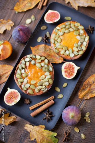 Pumpkin pies on a black plate © aprilante