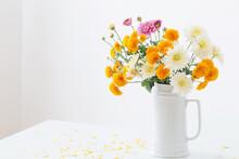 Chrysanthemum Flowers In White Jug On Background White Wall
