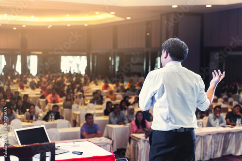 Asian businessman giving speech presentation stage meeting hall conference profe Canvas