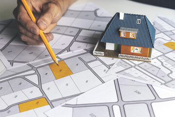 choose a building plot of land for house construction on cadastral map